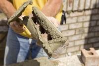 Southampton, praca Anglia na budowie dla murarzy przy murowaniu bloczków i cegieł
